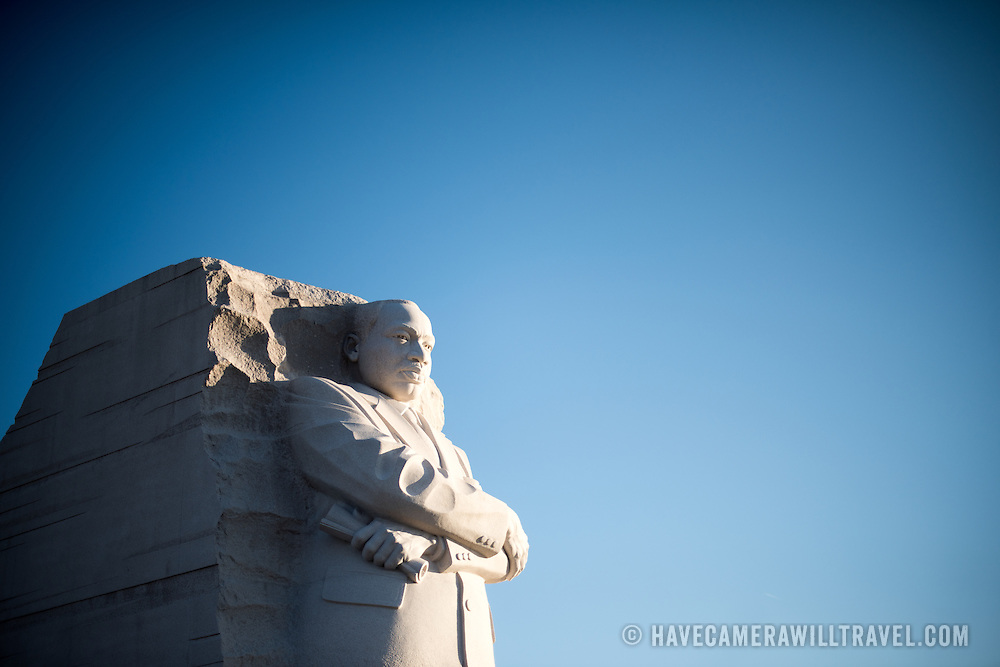 The main statue of Dr. Martin Luther King Jr. at the MLK Memorial on the banks of the Tidal Basin in Washington DC. The main statue, by Chinese sculptor Lei Yixin, stands here against a clear blue sky with copyspace.