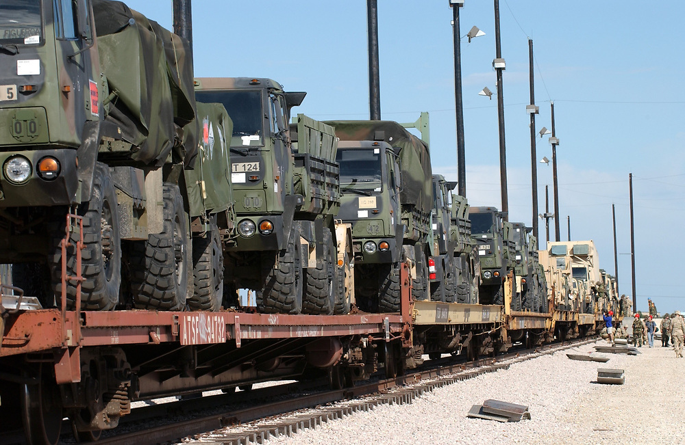November 18, 2003 Fort Hood, Texas USA: Soldiers from Fort Hood secure vehicles bound for Iraq to rail cars Tuesday as this sprawling central Texas army base prepares for a massive January troop deployment.  About 20,000 soldiers will leave from Fort Hood, the largest army base in the free world. Photo ©Bob Daemmrich , Inc.