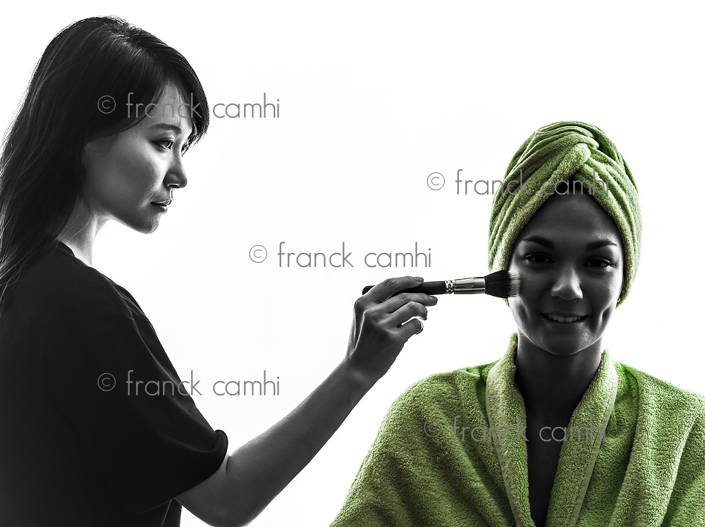 woman and make up artist in silhouette on white background