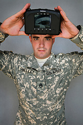 Staff Sergeant Aaron Smelley, 26. Houston, Texas. Soldiers from Alpha Battery 3-321 Field Artillery in Afghanistan's eastern Khost Province at the Terezayi District Center near the Afghan-Pakistan border on Friday Oct. 17, 2008.