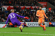 Mohamed Salah of Liverpool (r) shoots past Stoke City Goalkeeper Lee Grant to score his teams 3rd goal. Premier league match, Stoke City v Liverpool at the Bet365 Stadium in Stoke on Trent, Staffs on Wednesday 29th November 2017.<br /> pic by Chris Stading, Andrew Orchard sports photography.