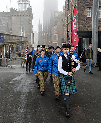 Pictured: the relay team are piped up the Royal Mile onto the Castle Esplanade.<br /> <br /> As part of the FAF 100 celebrations the relay team carrying a baton round the country arrived in Edinburgh, where they paraded up the Royal Mile and were met at Edinburgh Castle by the Lord Provost Frank Ross.<br /> <br /> © Dave Johnston / EEm