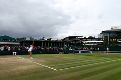 General view of the wear and tear to the grass on the baseline of court ten as Mai Hontama serves on day eight of the Wimbledon Championships at The All England Lawn Tennis and Croquet Club, Wimbledon.