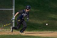 Goshen, New York - A John S. Burke Catholic player drops his bat after bunting the ball a varsity boys' baseball game on April 21, 2014.