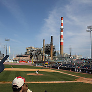 The Bridgeport Harbor Power Station provides a back drop to the ballpark during the Bridgeport Bluefish V York Revolution, Atlantic League, Minor League ballgame at Harbor Yard Ballpark, Bridgeport, Connecticut, USA. Photo Tim Clayton