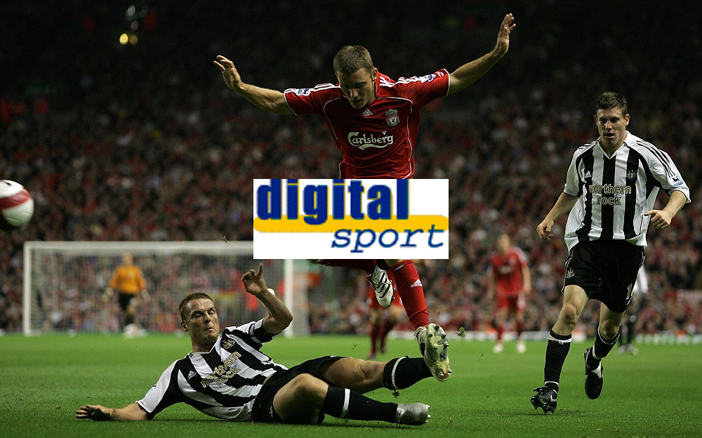 Photo: Paul Thomas.<br /> Liverpool v Newcastle United. The Barclays Premiership. 20/09/2006.<br /> <br /> Scott Parker (L) of Newcastle tackles Fabio Aurelio, watched by James Milner (R).