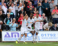 Tammy Abraham of Swansea city © celebrates with teammates Roque Mesa (l) and Kyle Naughton ® after he scores his teams 1st goal to equalise at 1-1. Premier league match, Swansea city v Watford at the Liberty Stadium in Swansea, South Wales on Saturday 23rd September 2017.<br /> pic by  Andrew Orchard, Andrew Orchard sports photography.
