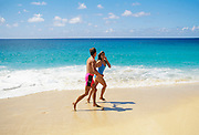 Couple on beach; North Shore; Oahu