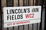 Street sign for Lincoln's Inn Fields, WC2. This area of central London is where many of the law courts are based in addition to offices of those involved in the law business.