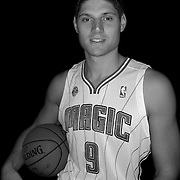 Nikola Vucevic poses in front of a backdrop during the Orlando Magic media day event at the Amway Arena on Monday, September 30, 2103 in Orlando, Florida. (AP Photo/Alex Menendez)