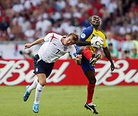 Photo: Chris Ratcliffe.<br /> England v Ecuador. 2nd Round, FIFA World Cup 2006. 25/06/2006.<br /> David Beckham of England clashes with Neicer Reasco of Ecuador.