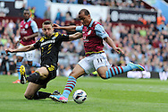 Chelsea's Gary Cahill (l) slides in to block Aston Villa's Gabriel Agbonlahor. Barclays Premier League, Aston Villa v Chelsea at Villa Park in Birmingham on Saturday 11th May 2013. pic by Andrew Orchard,  Andrew Orchard sports photography,