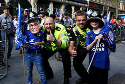 Young Leicester City fans pose with Policeman - Mandatory by-line: Robbie Stephenson/JMP - 16/05/2016 - FOOTBALL - Leicester City FC, Barclays Premier League Winners 2016 - Leicester City Victory Parade