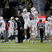 ORLANDO, FL - OCTOBER 03:  Zeaven Collins #23 of the Tulsa Golden Hurricane celebrates his pass interception with L.J. Wallace #20 of the Tulsa Golden Hurricane against the Central Florida Knights at Bright House Networks Stadium on October 3, 2020 in Orlando, Florida. (Photo by Alex Menendez/Getty Images) *** Local Caption *** Zeaven Collins;  L.J. Wallace