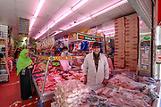 """Raj is a happy man selling his favourite Halal Meat in a store near """"East Street Market"""" in Walworth, South London.<br /> Although school children and many others are reportedly having troubles with vouchers a grocery retailer in South London is exchanging his groceries for vouchers on Tuesday, May 5, 2020.<br /> Under a government scheme, families in need in England should receive vouchers worth £15 a week per child. Whilst a few European countries relax the COVID-19 lockdown, Britain still remains under lockdown without an exit strategy yet. (Photo/Vudi Xhymshiti)"""