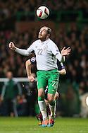 Richard Keogh of Ireland heads the ball back to his goal keeper - UEFA Euro 2016 Qualifier - Scotland vs Republic of Ireland - Celtic Park Stadium - Glasgow - Scotland - 14th November 2014  - Picture Simon Bellis/Sportimage