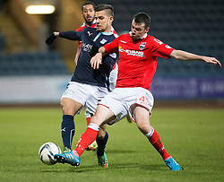 Dundee's Luka Tankulic and Ross County's Paul Quinn. <br /> Dundee 1 v 1 Ross County, SPFL Premiership game player 4/1/2015 at Dundee's home ground Dens Park.