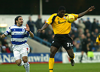 Photo. Chris Ratcliffe<br /> QPR v Rushden & Diamonds. Nationwide Division 2. 03/01/2004<br /> Onandi Lowe of Rushden and Gino Padula of QPR battle for the ball
