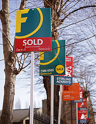 File photo dated 01/03/15 of a row of Sold and For Sale signs. House prices grew faster than expected in July, hitting a record high as pressure on household finances begins to ease, according to Halifax.