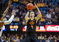 Jan 12, 2019; Morgantown, WV, USA; Oklahoma State Cowboys guard Thomas Dziagwa (4) shoots a three pointer during the first half against the West Virginia Mountaineers at WVU Coliseum. Mandatory Credit: Ben Queen-USA TODAY Sports
