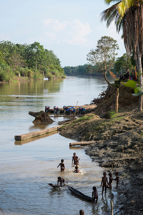 Children play on the riverbank in the village of Yar, located on the Keram River in the East Sepik Province of Papua New Guinea.<br /><br />(June 21, 2019)