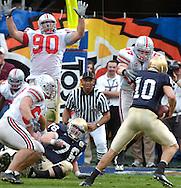 Linebacker A.J. Hawk, right, and the Ohio State defense sack Notre Dame quarterback Brady Quinn last night in the second quarter.