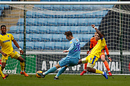 Wimbledon defender Adedeji Oshilaja (4) with a block  during the EFL Sky Bet League 1 match between Coventry City and AFC Wimbledon at the Ricoh Arena, Coventry, England on 12 January 2019.