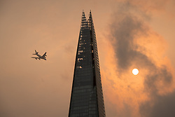 Review of the Year 2017: October: A plane flies past the Shard in central London, as the sky takes on an unusual orange colour caused by Storm Ophelia.