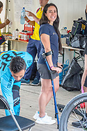 Mariana Pajon in crutches after her crash in Papendal, with her team at Round 5 of the 2018 UCI BMX Superscross World Cup in Zolder, Belgium