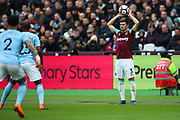 West Ham United defender Aaron Cresswell (3) takes a throw in during the Premier League match between West Ham United and Manchester City at the London Stadium, London, England on 29 April 2018. Picture by Toyin Oshodi.