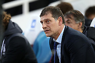 West Ham United manager Slaven Bilic sits in the dugout before k/o. Barclays Premier league match, West Ham Utd v Stoke city at the Boleyn Ground, Upton Park  in London on Saturday 12th December 2015.<br /> pic by John Patrick Fletcher, Andrew Orchard sports photography.