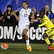 Tobin Heath, (left), USA, dribbles past Leidy Asprilla, Colombia, during the USA Vs Colombia, Women's International friendly football match at the Pratt & Whitney Stadium, East Hartford, Connecticut, USA. 6th April 2016. Photo Tim Clayton