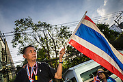 27 NOVEMBER 2013 - BANGKOK, THAILAND: Protestors ride in a pickup truck into the Ministry of Finance in Bangkok. There is still no sign of police or security personnel at the ministry and there has been no effort to expel protestors. Anti-government protestors continue to occupy the Ministry of Finance in Bangkok. Protests also spread to other government ministries and several provinces in southern Thailand, a stronghold of the opposition.      PHOTO BY JACK KURTZ