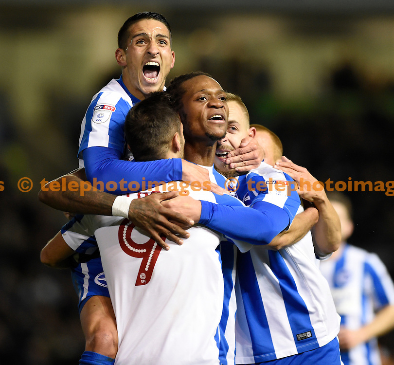 Brighton's players celebrate their first goal scored by Sam Baldock during the Sky Bet Championship match between Brighton and Hove Albion and Wolverhampton Wanderers at the American Express Community Stadium in Brighton and Hove. October 18, 2016.<br /> Simon  Dack / Telephoto Images<br /> +44 7967 642437