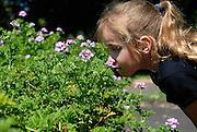 Child (10 years old) smelling the flowers. Royal Botanic Gardens, Sydney, Australia