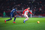 Danny Andrew of Doncaster Rovers (3) takes on Elvis Bwomono of Southend United (2) during the EFL Sky Bet League 1 match between Doncaster Rovers and Southend United at the Keepmoat Stadium, Doncaster, England on 12 February 2019.