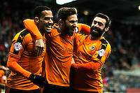 Wolverhampton Wanderers goalscorer James Henry, centre, with team-mates Jack Price, right, and Jordan Graham as he celebrates the opening goal