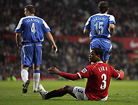 Photo: Paul Thomas.<br />Manchester United v Wigan Athletic. The Barclays Premiership. 26/12/2006.<br /><br />Patrice Evra looks at the referee after being fouled in the box by Leighton Baines (out of picture).