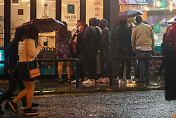 © Licensed to London News Pictures. 03/10/2020. Liverpool, UK. Drinkers not deterred by bad weather of Storm Alex in Liverpool as well as newly imposed lockdown restrictions which prevent socialising indoors with other households. Photo credit: Kerry Elsworth/LNP