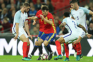 David Silva of Spain tries to go past Jordan Henderson, the England captain (l) and Nathaniel Clyne of England. England v Spain, Football international friendly at Wembley Stadium in London on Tuesday 15th November 2016.<br /> pic by John Patrick Fletcher, Andrew Orchard sports photography.