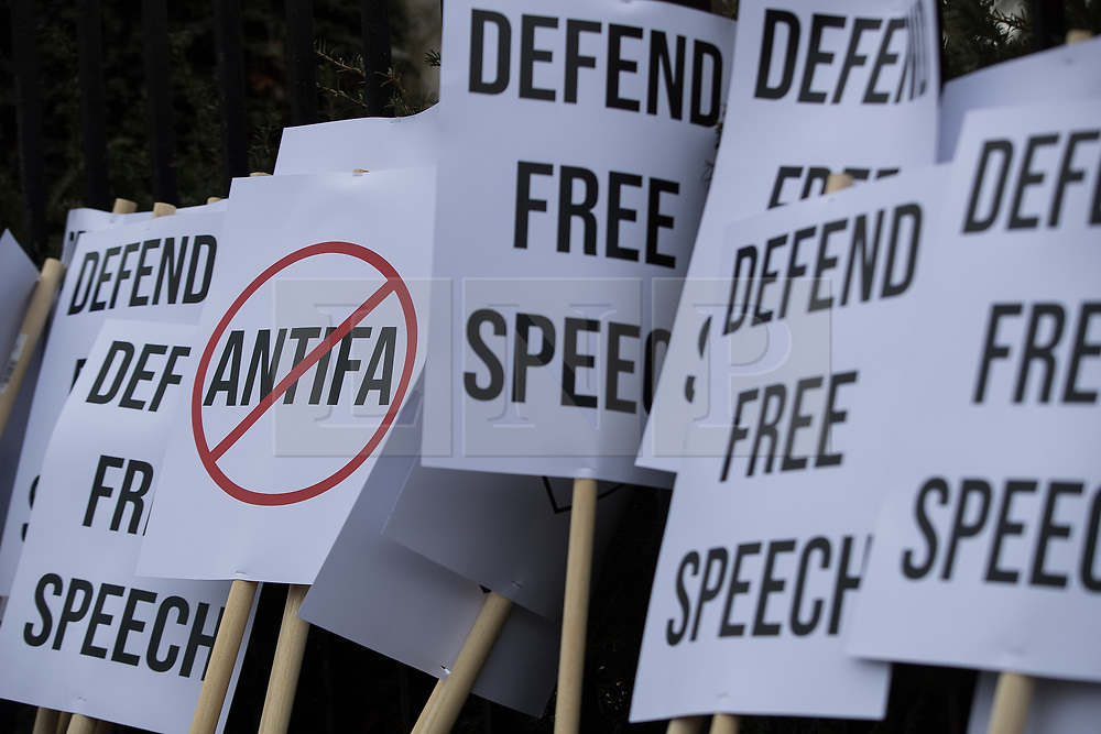 """© Licensed to London News Pictures. 11/03/2018. London, UK. Alt-right supporters with an anti antifa and """" Defend free speech """" placards . Alt right group Generation Identity and other far-right groups hold a demonstration at Speakers' Corner in Hyde Park , opposed by antifascists . Generation Identity supporters Martin Sellner and Brittany Pettibone were due to speak at the demo but were arrested and detained by police when they arrived in the UK , also forcing them to cancel an appearance at a UKIP """" Young Independence """" youth event , which in turn was reportedly cancelled amid security concerns . Photo credit: Joel Goodman/LNP"""