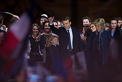 Emmanuel Macron is surrounded on stage by wife Brigitte and family members after winning the French presidential election, at the Louvre Pyramid in Paris, France on May 7, 2017. Macron, a 39-year-old pro-business centrist, defeated Marine Le Pen, a far-right nationalist who called for France to exit the European Union, by a margin of 65.5 % to 34.1%, becoming the youngest president in France's history. Photo by Eliot Blondet/ABACAPRESS.COM