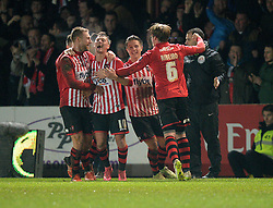 Lee Holmes of Exeter City celebrates his goal with team mates. - Mandatory byline: Alex James/JMP - 08/01/2016 - FOOTBALL - St James Park - Exeter, England - Exeter City v Liverpool - FA Cup Third Round