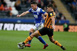 Hull City's Eric Lichaj (right) challenges Birmingham City's Kerim Mrabti