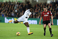 Wilfried Bony of Swansea city has a shot at goal.Barclays Premier league match, Swansea city v Queens Park Rangers at the Liberty stadium in Swansea, South Wales on Tuesday 2nd December 2014<br /> pic by Andrew Orchard, Andrew Orchard sports photography.