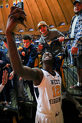 Nov 24, 2018; Morgantown, WV, USA; West Virginia Mountaineers forward Andrew Gordon (12) takes a selfie with a fan after beating the Valparaiso Crusaders at WVU Coliseum. Mandatory Credit: Ben Queen-USA TODAY Sports