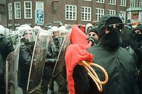 """16 DEC 1995, HAMBURG/GERMANY:<br /> Vermummter Demonstrant vor Polizeikette, waehrend einer Demonstration unter dem Motto """"Radikal ins naechste Jahrtausend"""", Gaensemarkt<br /> IMAGE: 19951216-01/01-36<br /> KEYWORDS: Polizei, police, Demo, Demonstrator, Krawall,"""