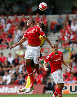 Photo: Steve Bond/Richard Lane Photography.<br />Nottingham Forest v Watford. Coca-Cola Football League Championship. 23/08/2008. Gareth McCleary wins an aeriel challange