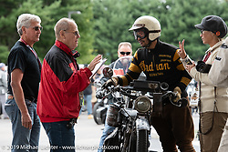 Niimi checks in with John Classen and Jim Feeney (with the help of Ayu) at the daily finish in Keane during the Motorcycle Cannonball coast to coast vintage run. Stage-1 (145-miles) from Portland, Maine to Keene, NH. Saturday September 8, 2018. Photography ©2018 Michael Lichter.