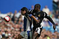 Photo: Lee Earle.<br /> Portsmouth v Wigan Athletic. The Barclays Premiership. 09/09/2006. Portsmouth's Dejan Stefanovic (L) holds off Emile Heskey.